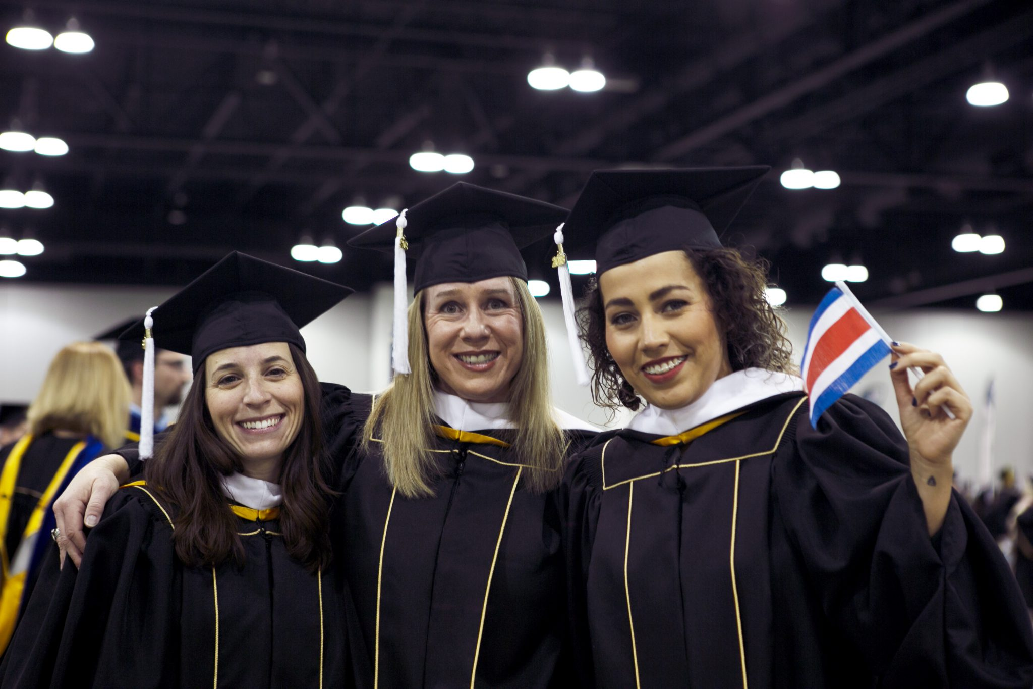 Image of three SEHD grad students at fall commencement 2018