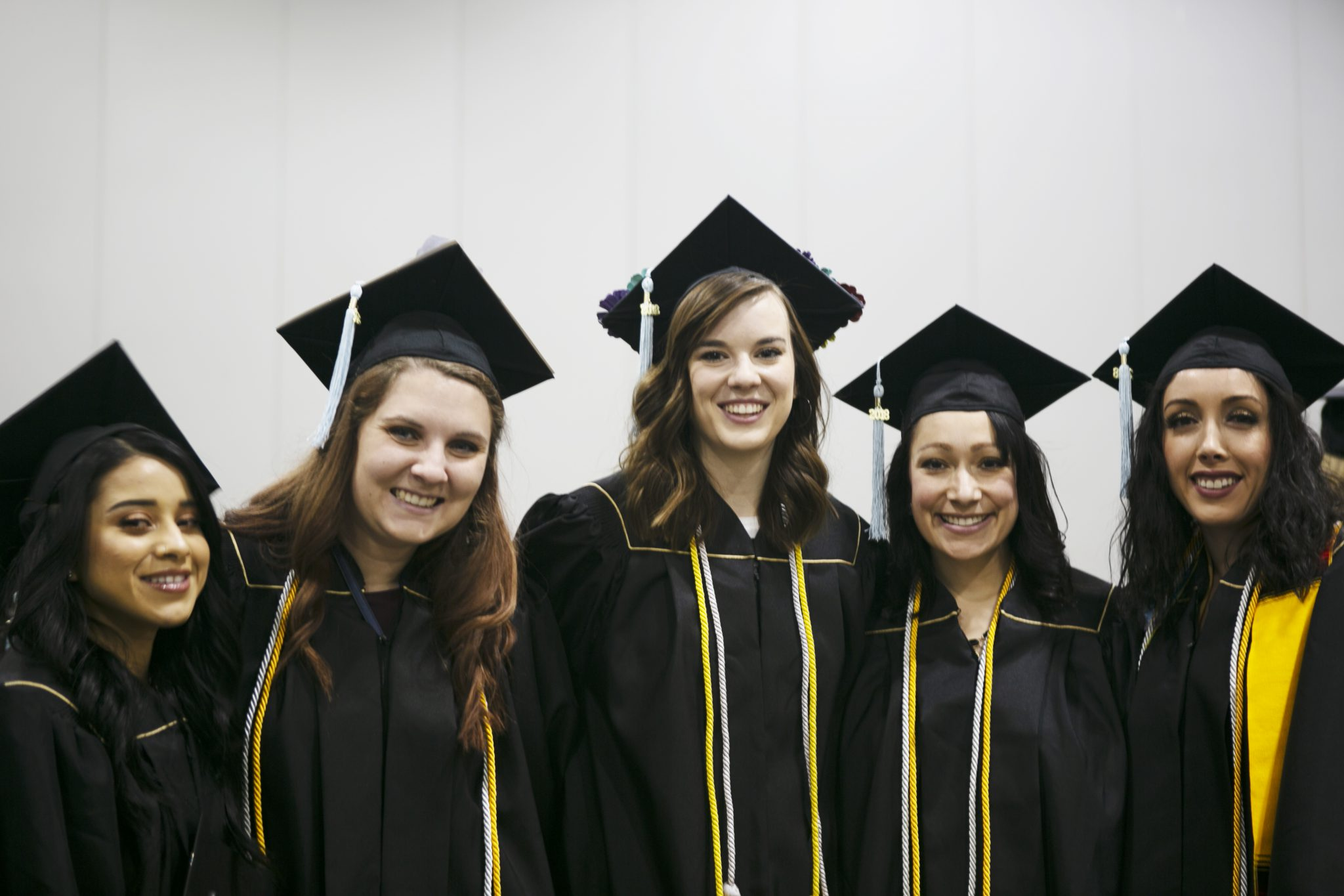 image of  five  undergrad students at fall commencement 2018