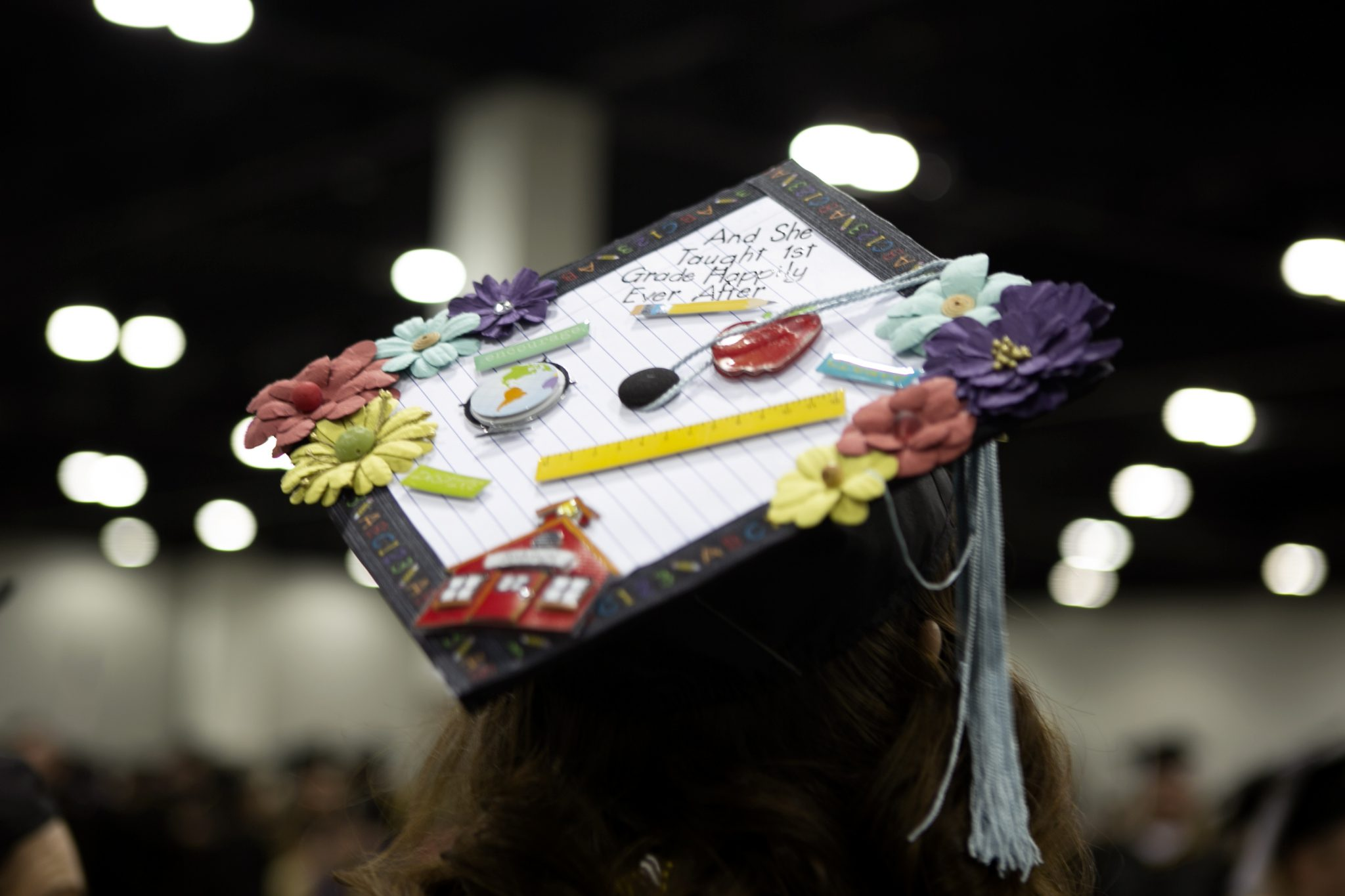 "Student grad cap. Says ""and she taught first grade happily ever after"""