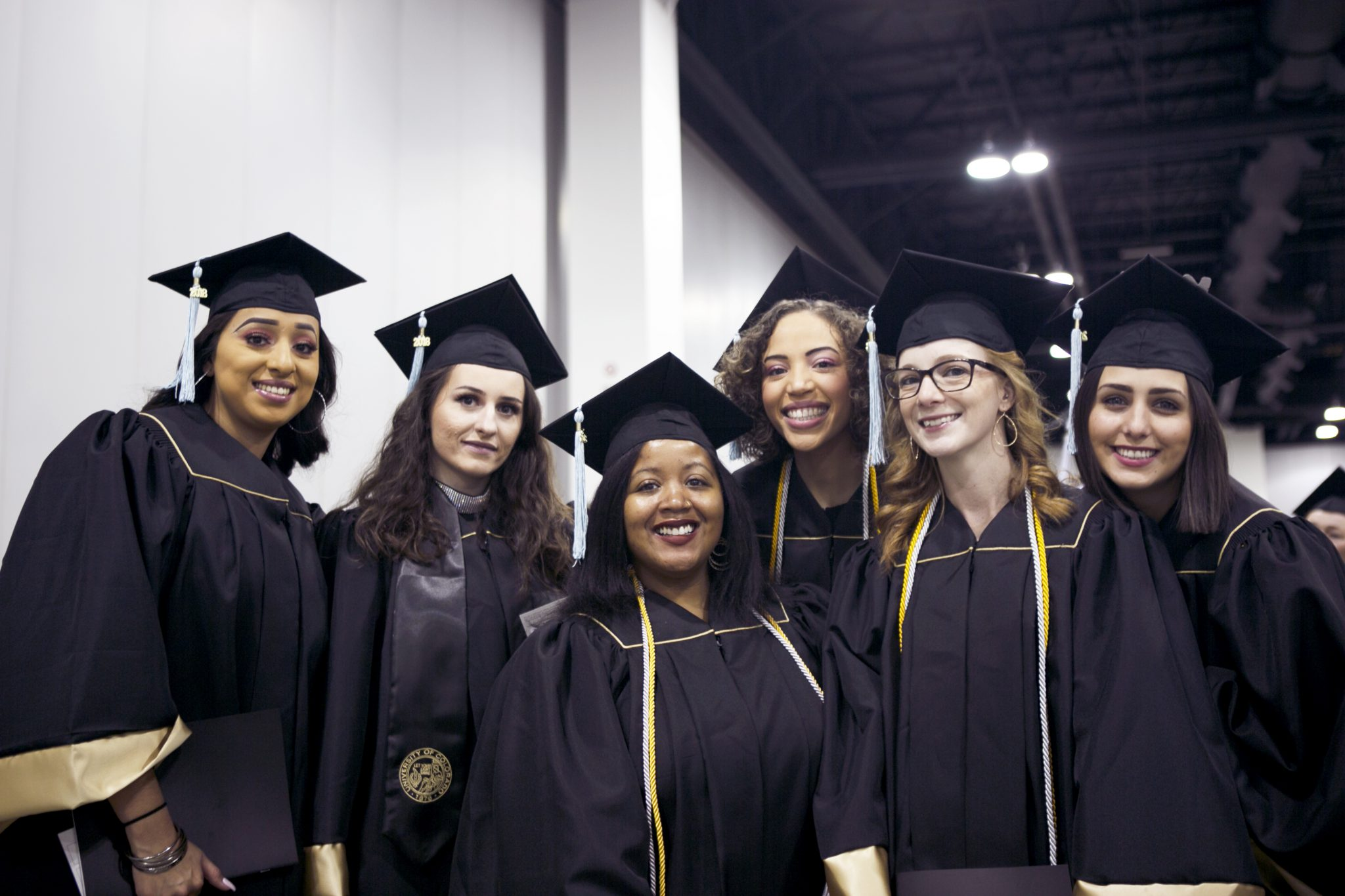 six undergraduate cohort members in group photo at fall commencement 2018