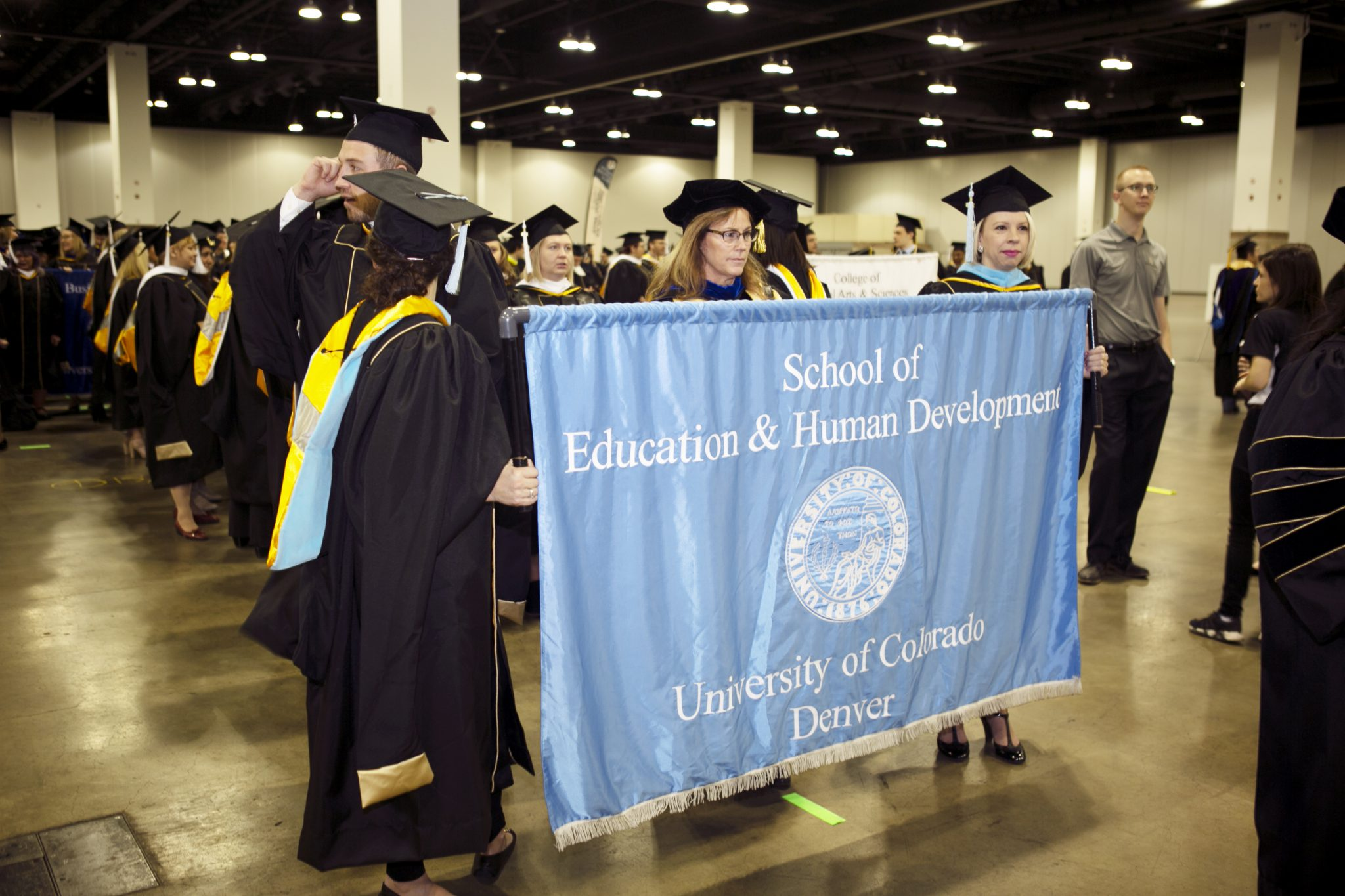 Image of SEHD grad banner being held during Fall Commencement