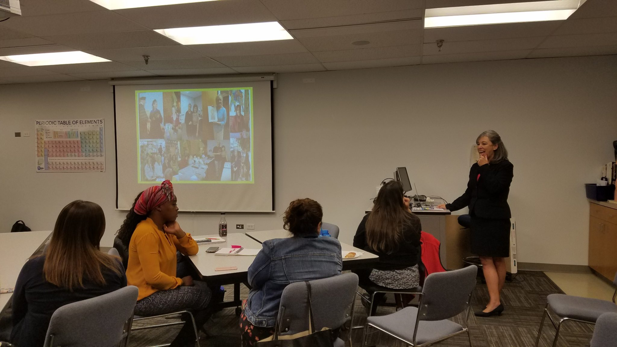 Image of Maria Uribe lecturing at Faculty Symposium